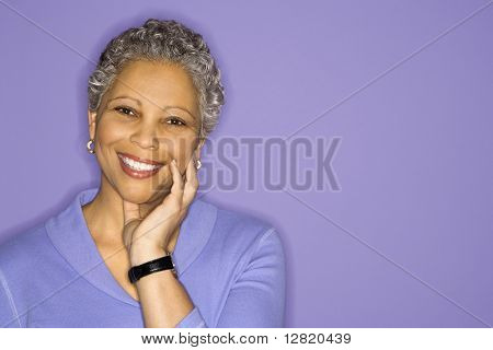 African American mature adult female smiling looking at viewer.