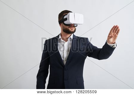 Close up of businessman in a formal wear and virtual reality glasses