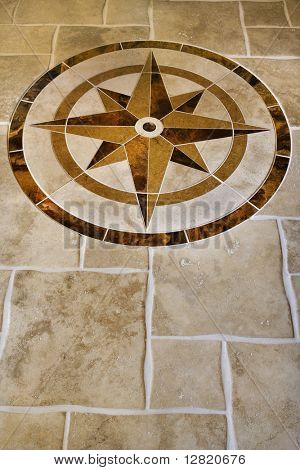 Marble floor with star shape in affluent home.