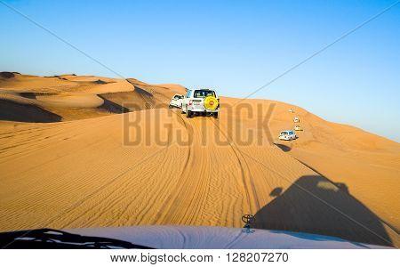 Dubai U.A.E. - February 15 2007: Off the road cars in the Al Dhana desertic area