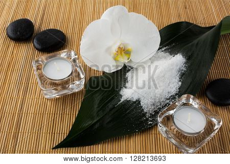 Spa and wellness concept with sea salt and orchid. Spa. Spa stones. Wellness spa. Spa concept