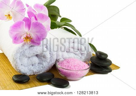 Spa concept with pink orchid isolated on white. Spa. Spa treatment. Spa massage. Spa stones. Wellness spa. Spa concept