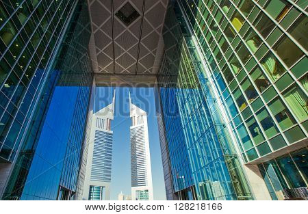 Dubai U.A.E. - February 18 2007: The architectures of the business area of the Sheik Zaied Road. The Emirates Towers in the background