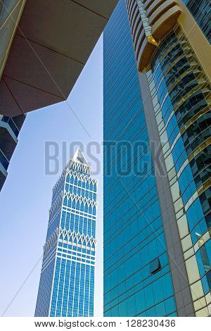 Dubai U.A.E. - November 15 2006: The beautifull architectures of the business area of the Sheik Zaied Road. In the background The Tower.