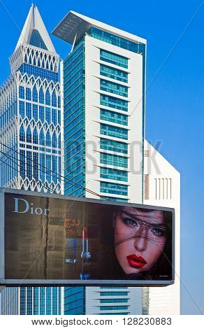 Dubai U.A.E. - November 15 2006: A billboard in front of the architectures of the business area of the Sheik Zaied Road.