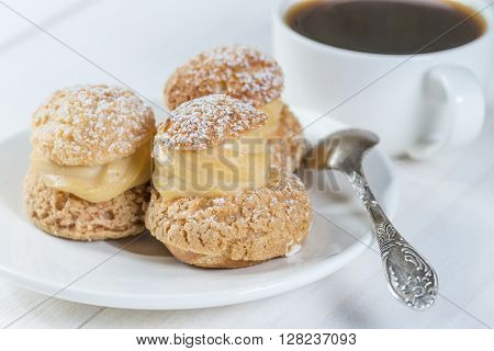 shu cake with cream with coffee shallow dof
