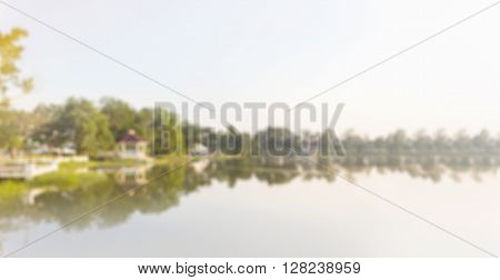 Blurred Background Of Green Tree And Pubblic Park View With Lake And Sky