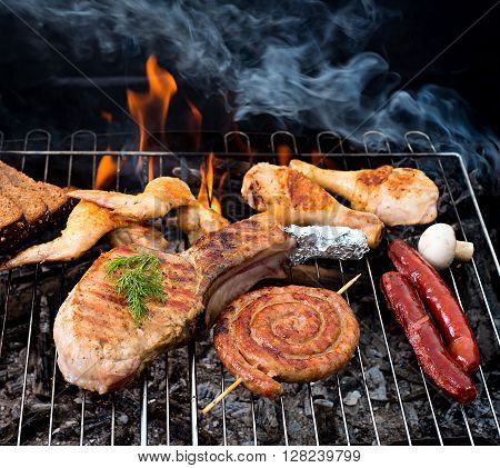 grill concept with flame.  A top sirloin steak flame broiled on a barbecue