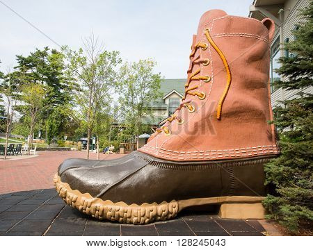 FREEPORT, MAINE, USA-AUG 31st, 2014: L.L. Bean is retail company founded in 1912 by Leon Leonwood Bean. A replica of its famous boot stands outside the flagship store.