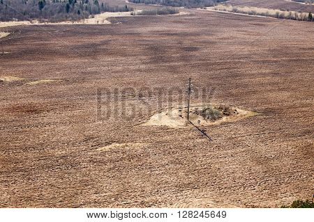 plowed field with power line. unsown field. top view