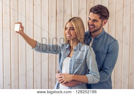Beautiful Young Couple With Gadget