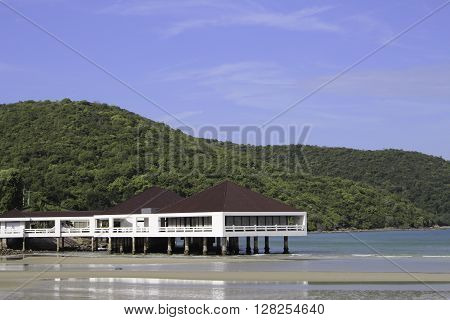 Toei Ngam Bay with its white sand beaches. Clear blue waters spectacular natural surroundings. The bay is surrounded by mountains and trees at the same time not far from shore.