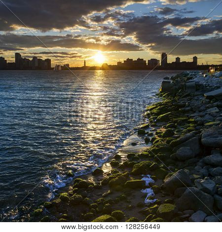 Sunset across the Hudson River with the New Jersey skyline seen from Manhattan New York City