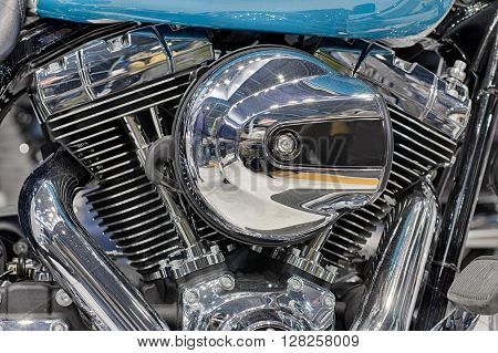 Detail Of  Air Cooled Twin Engine With Integrated Oil Cooler Of Motorcycle.