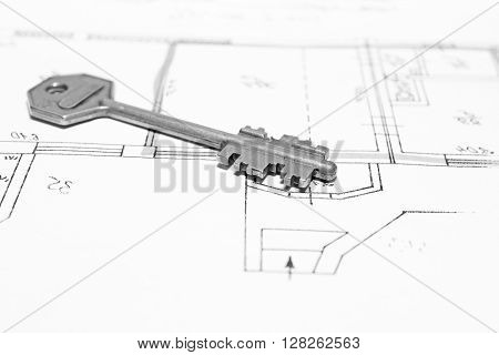 Close up of key on house plan, black and white photo
