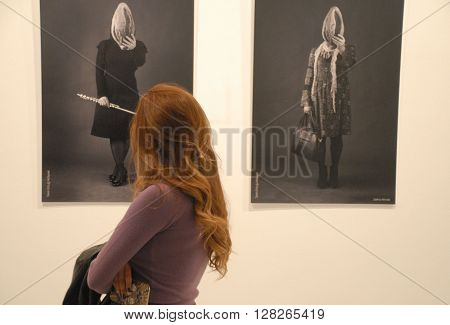 ANKARA/TURKEY-MARCH 26, 2016: Spectator at the CSM Art Gallery during the 6th Ankara Photo Days of FSK. March 26, 2016-Ankara/Turkey