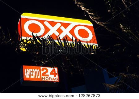 The Oxxo Franchise Of Convenience Stores At Zona Hotelera In The   Evening