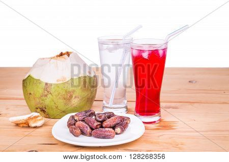 Coconut juice syrup and sweet dates are simple and common iftar break fast food during fasting month of Ramadan poster