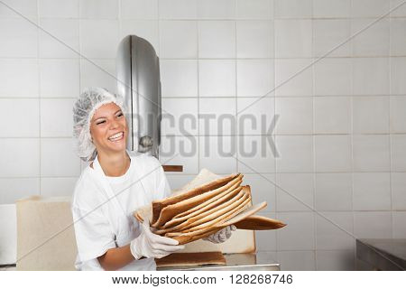 Baker Laughing While Holding Bread Waste