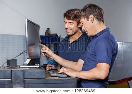 Mechanics Using Computer In Garage