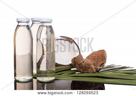 Cold Pressed Extra Virgin Coconut Oil In Bottles With Coconuts