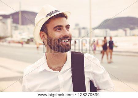 Tourist with hat looking around in vintage warm cinema look