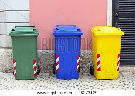 Recycling and Sorting Plastic Wheelie Bins Trash Cans