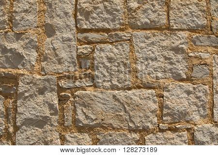 Closeup on rock wall with yellow mortar