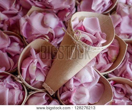 beautiful pink rose petals in paper bags for wedding