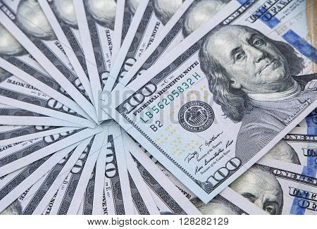 close up of fan shaped one hundred dollars banknotes