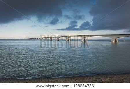 The Zeeland Bridge is the longest bridge in the Netherlands. The bridge spans the Oosterschelde estuary. It connects the islands of Schouwen-Duiveland and Noord-Beveland in the province of Zeeland.
