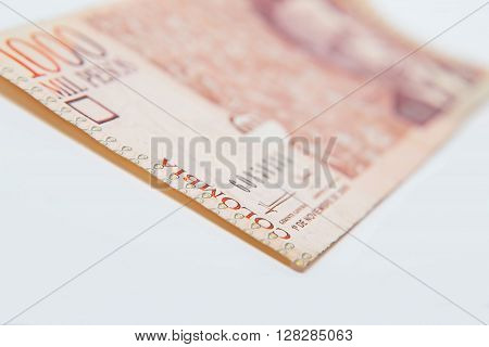 National currency of Colombia. Thousand Pesos on white background.  Close up macro