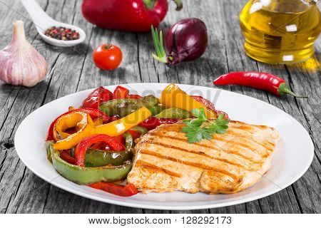 Delicious Grilled Chicken breast fillet and fried bell pepper clos- up