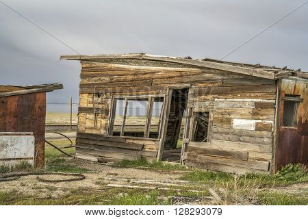 old abandoned store or gas station in a ghost town