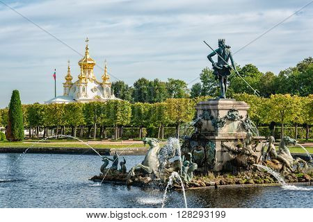 Petergof St Petersburg Russia - September 1 2012: View of Neptune fountain and orthodox palace church in Petergof