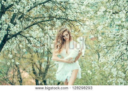 Woman With Goat In Blossom