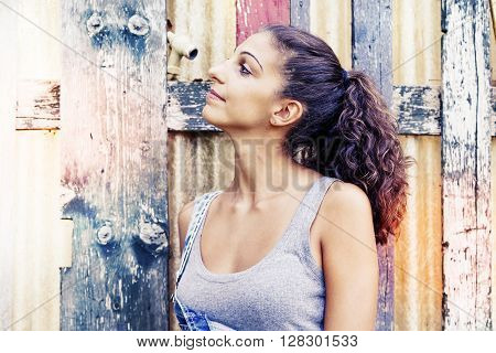 Portrait Of Young Woman On Wooden Scratched Background