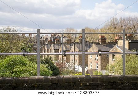 European urban city view behind the fence in West London United Kingdom