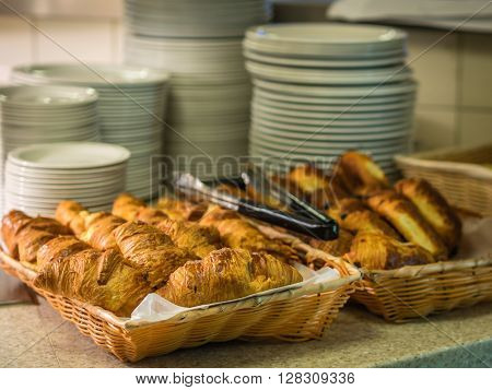 Croissants on a self service breakfast counter in a hotel restaurant