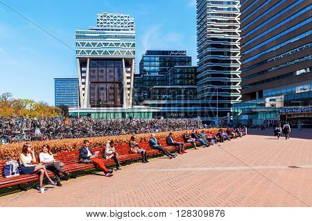The Hague Netherlands - April 21 2016: forecourt of the main station with unidentified people. It is with twelve tracks the largest terminal station in the Netherlands. It was completed in 1973