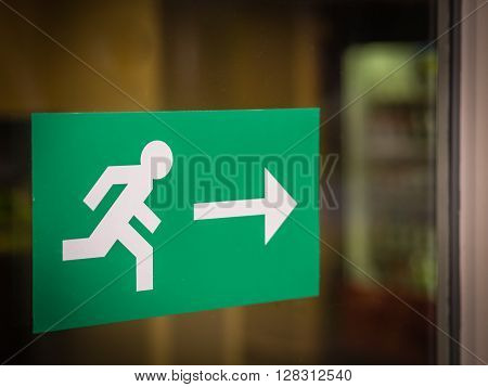 Green sign indicating the escape route in case of an emergency