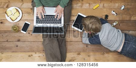 Mother and son using tablet and laptop hero header