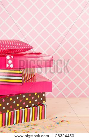 Colorful birthday presets on pink background