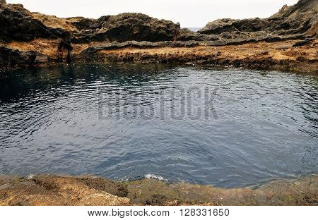 Natural salt water pool formed by volcanic lava runs on the coastline of the island of Brava part of the Archipelago of Cabo Verde