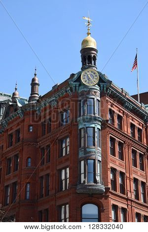 WASHINGTON DC - APR 17: Historic SunTrust building in Washington DC, as seen on April 17, 2016. The building is constructed in red brick, and elaborately detailed with copper and terra cotta.