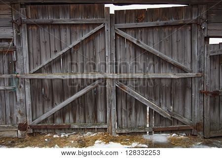 Old gray wooden plank vintage gray door