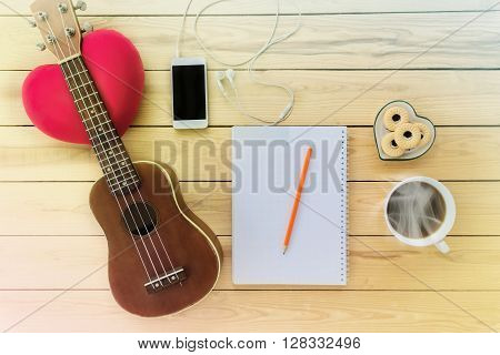 Blank Note Book And Pencil With Coffee,cookie, Mobile Phone And Ukulele