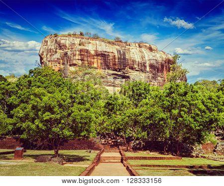 Vintage retro effect filtered hipster style image of Sigiriya rock - famous Sri Lankan tourist landmark, Sri Lanka