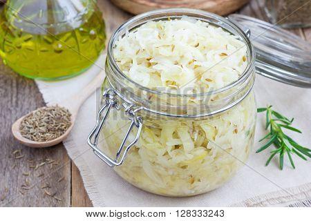 Homemade sauerkraut with cumin in a glass jar