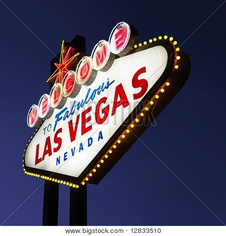 Lighted Las Vegas welcome sign with night sky.